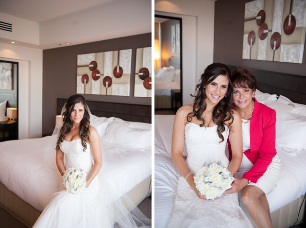 Bride and mother sitting on bed