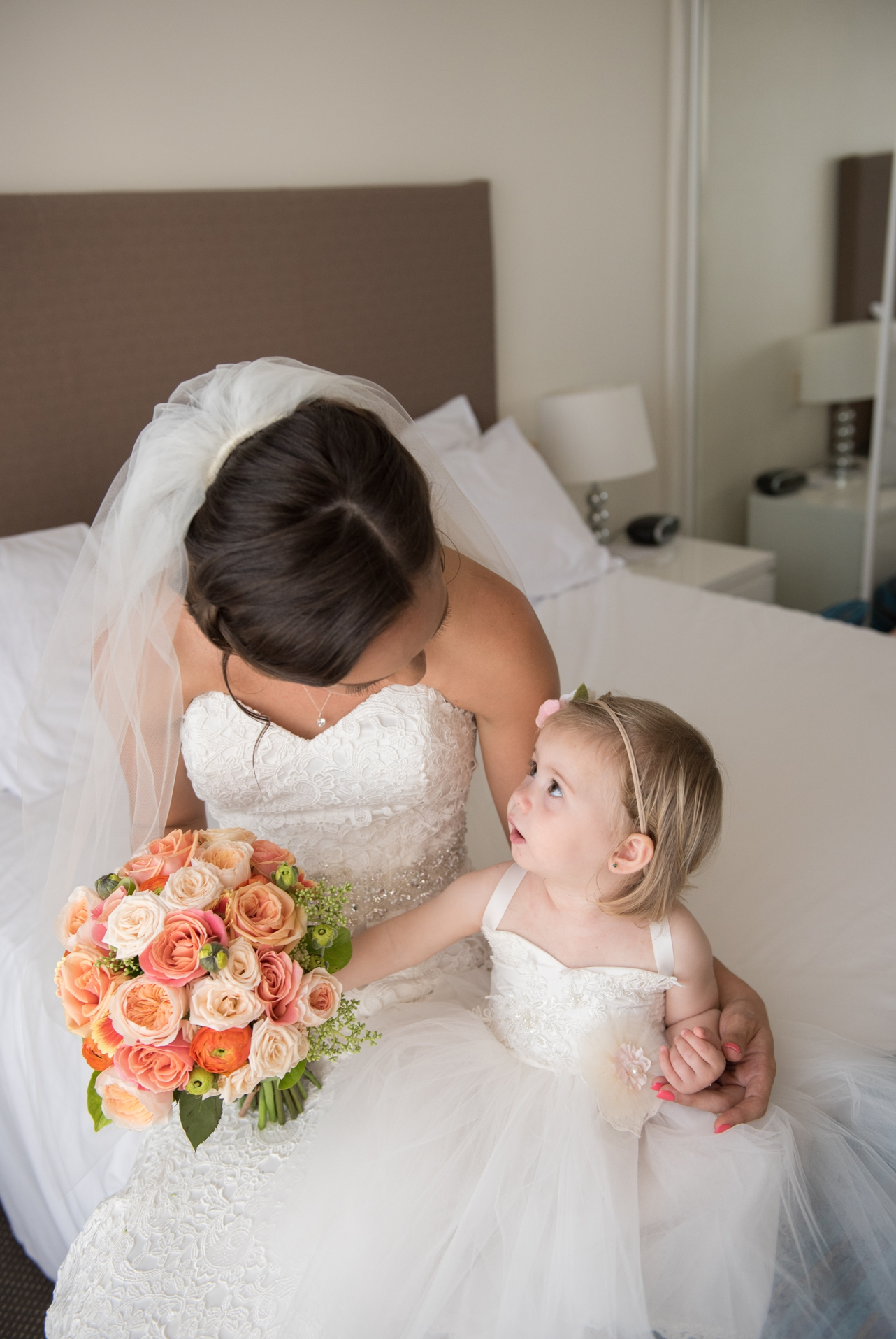 Bride_and_her_little_girl_having_a_moment