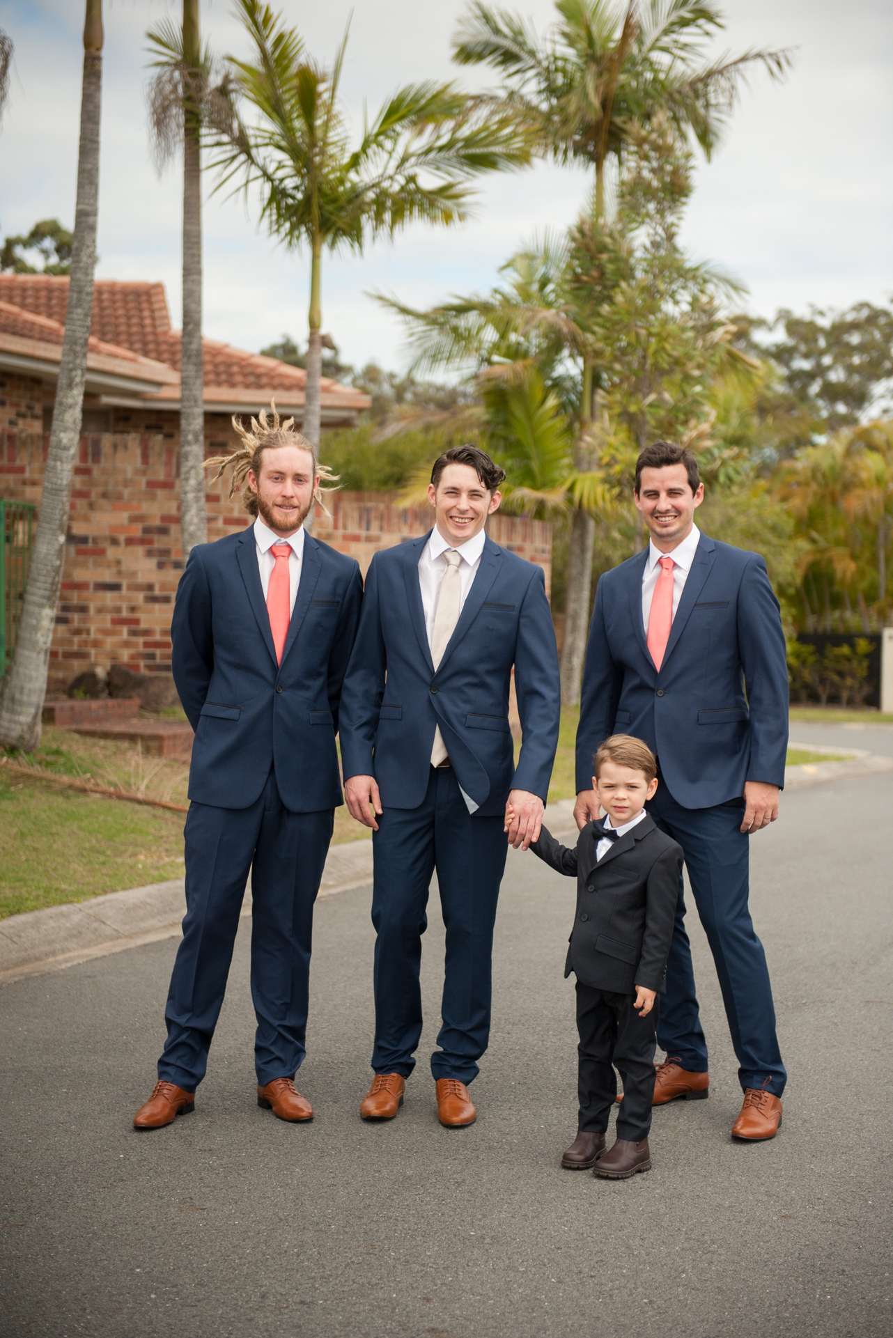 Groom_standing_with_his_paigeboy_and_groomsmen