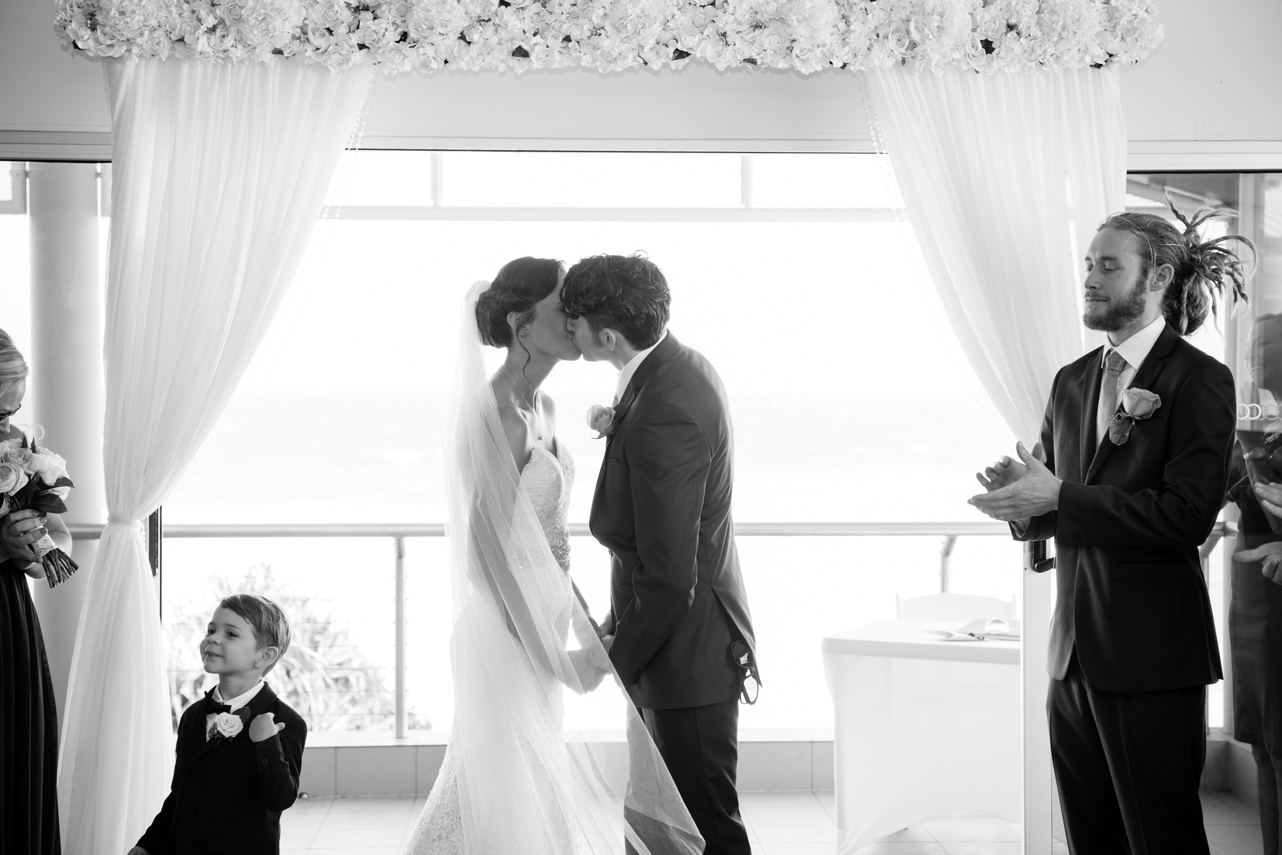 Bride_and_grooms_first_kiss_Pageboy_laughing