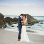 Bride_and_groom_on_burleigh_heads_beach_at_sunset_looking_at_each_other