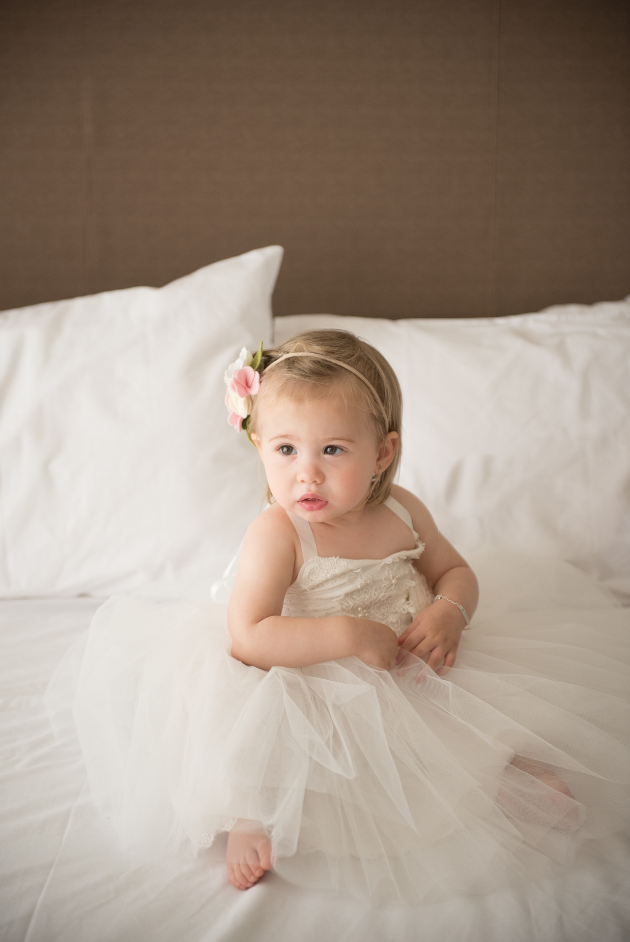 Gorgeous_little_flowergirl_sitting_on_the_bed