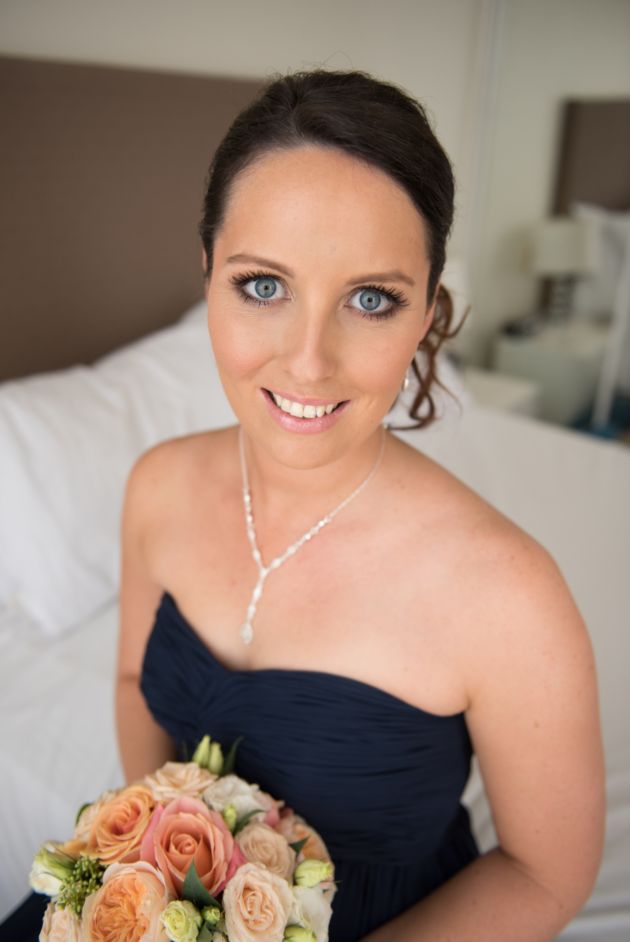 Beautiful_bridesmaid_looking_at_the_camera_holding_flowers
