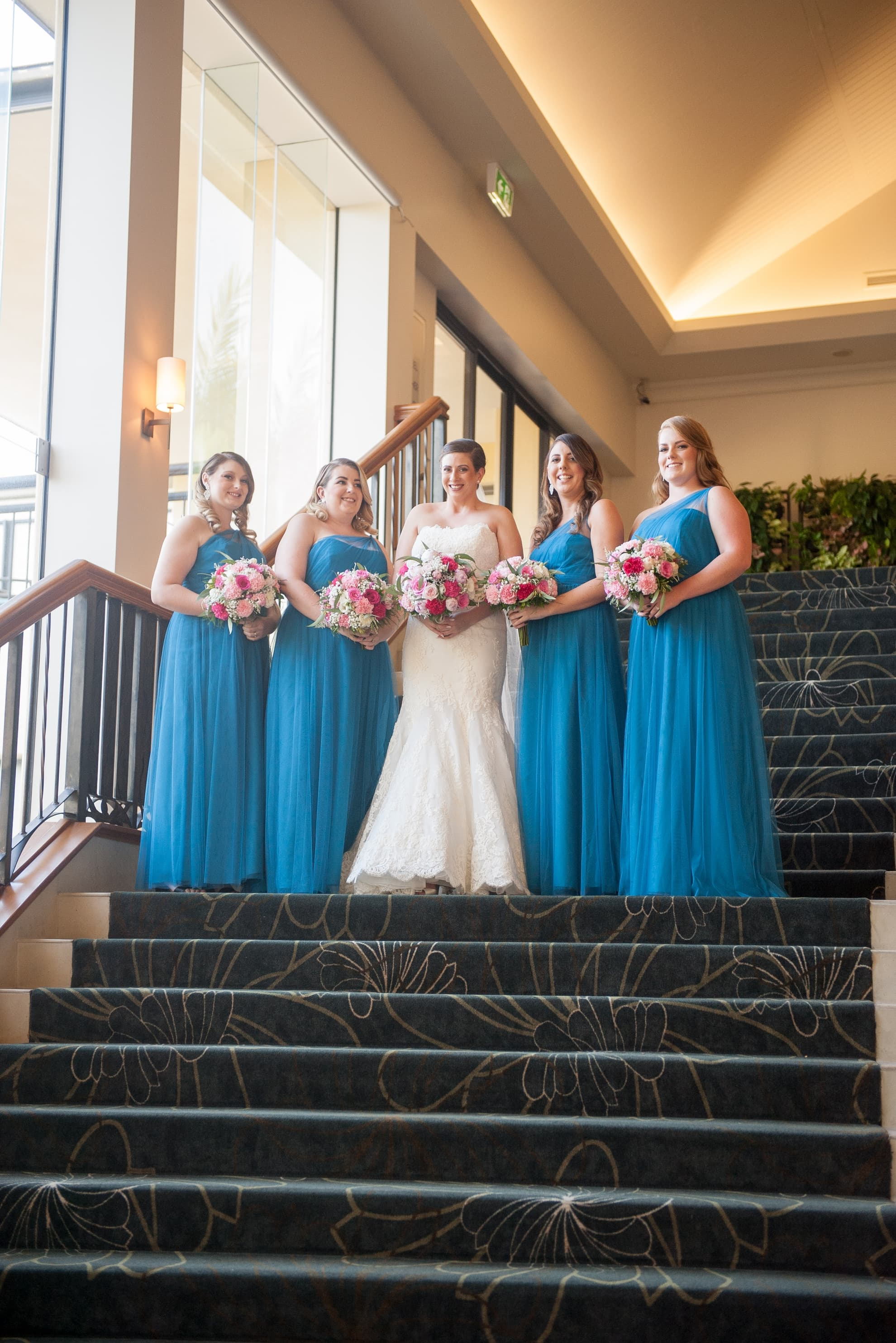 bride-and-her-bridesmaids-looking-at-each-other-smiling