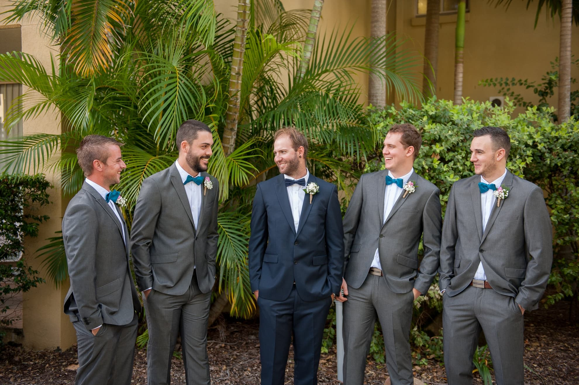 groomsmen-loking-at-each-other-smiling-and-having-a-good-time