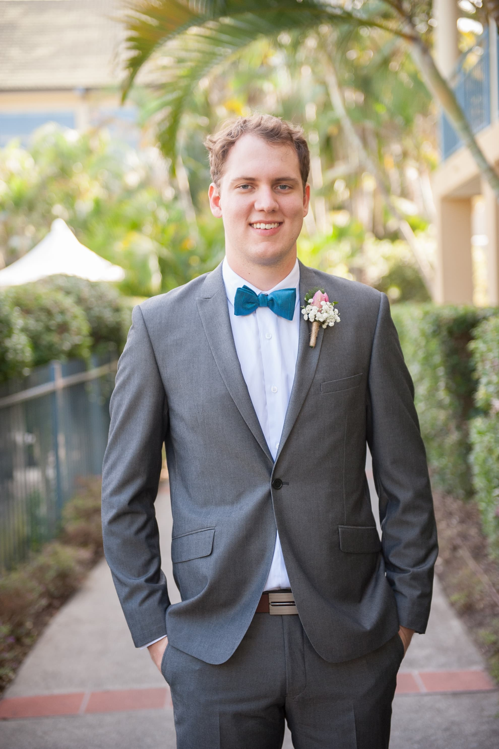 Groomsman-laughing-and-smiling-for-the-camera