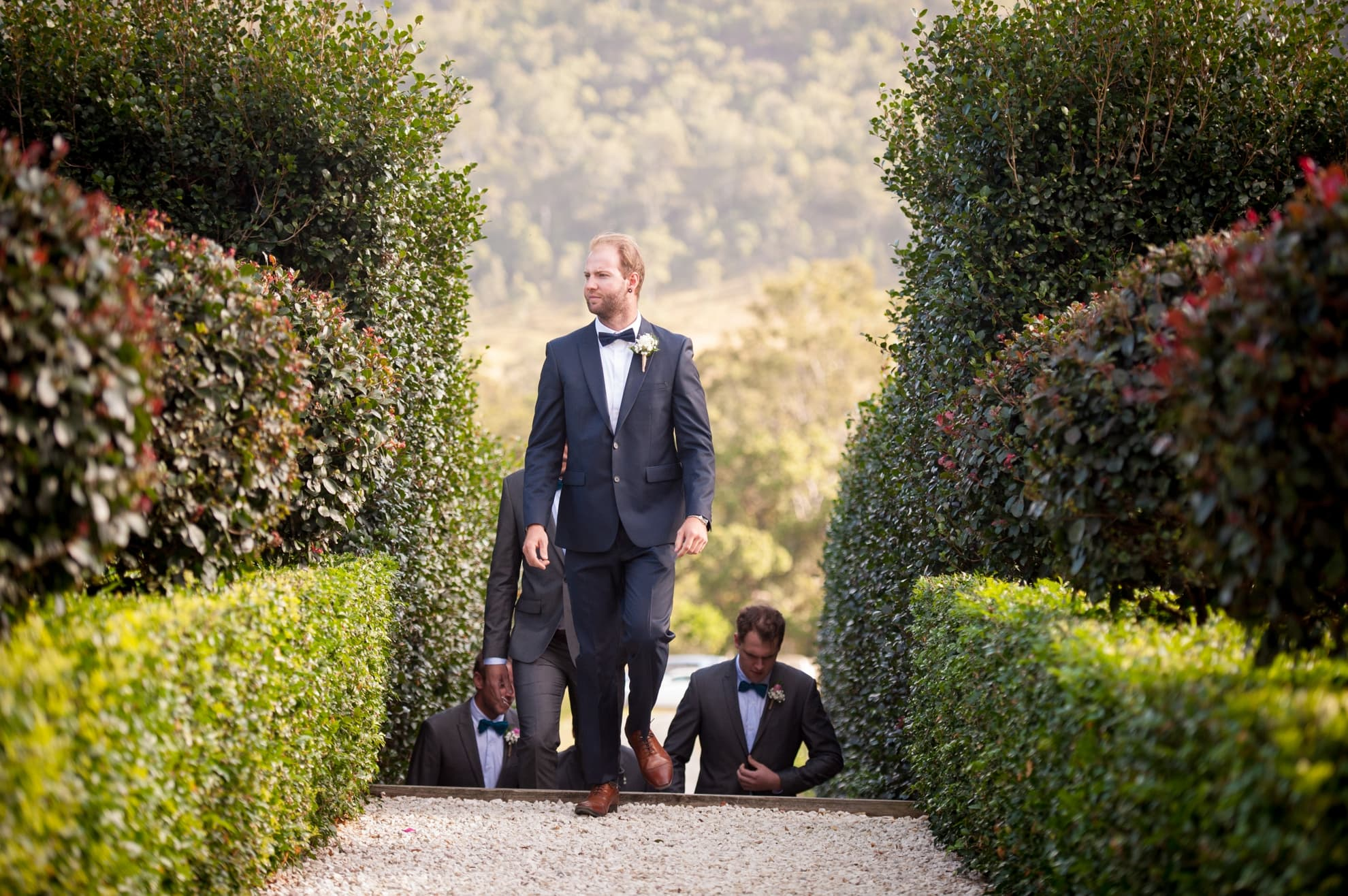 groom-walks-fast-up-the-garden-path-to-his-wedding-ceremony