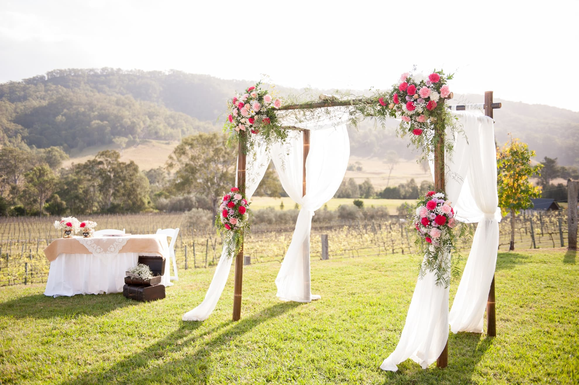 stunning-wedding-arbor-draping-flowing-in-the-wind-with-moutains-in-the-backdrop