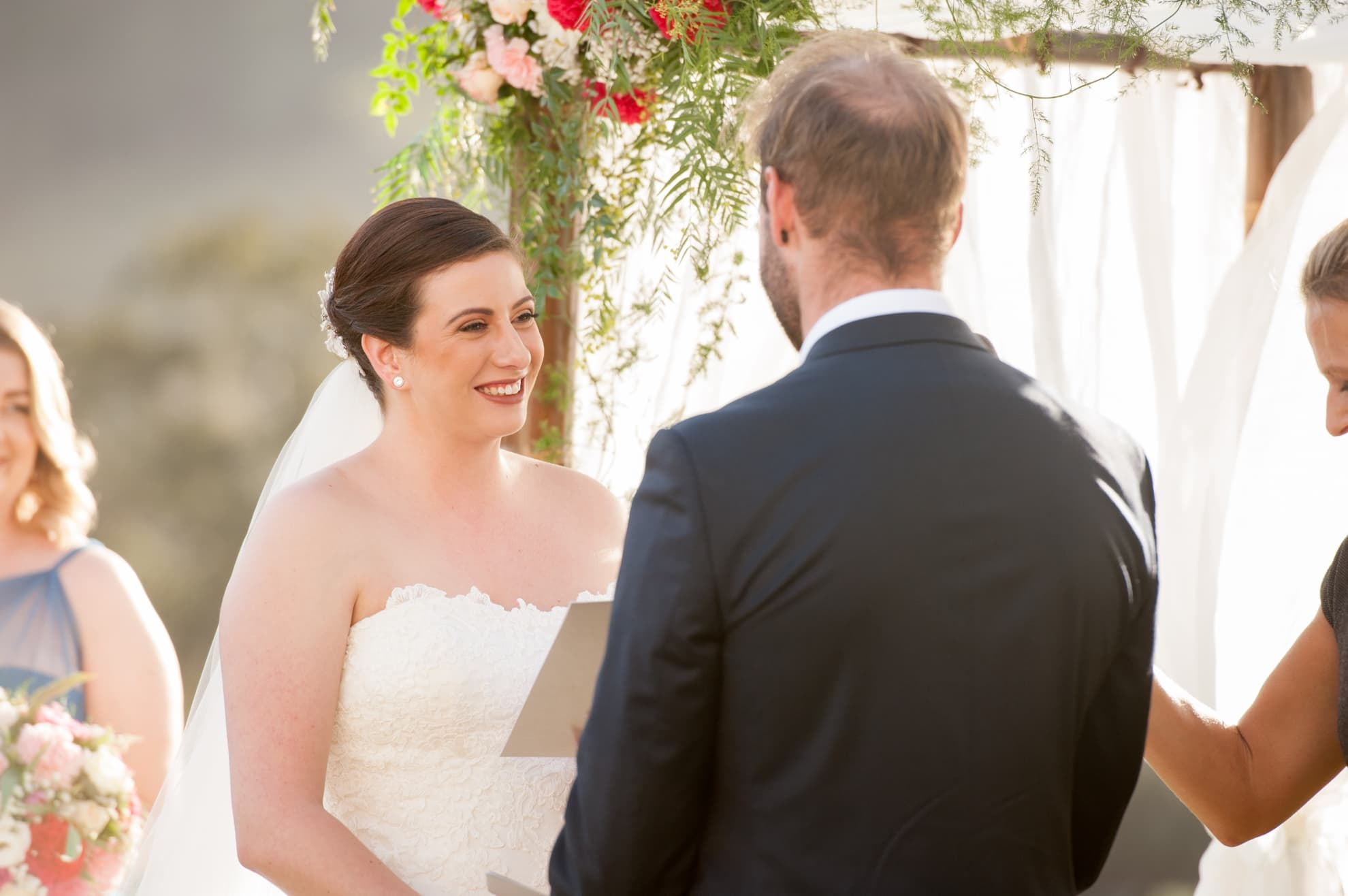 bride-smiling-at-her-groom-during-the-ceremony