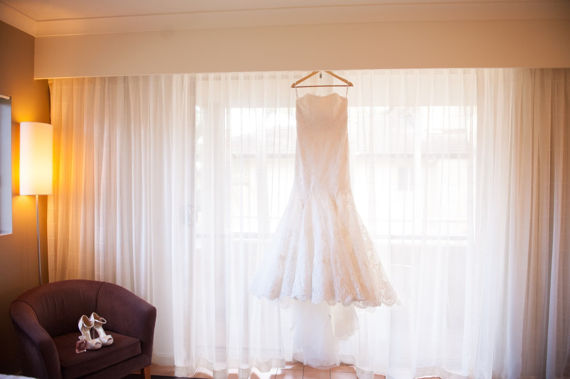 wedding-dress-hung-up-on-the-window-falling-elegantly
