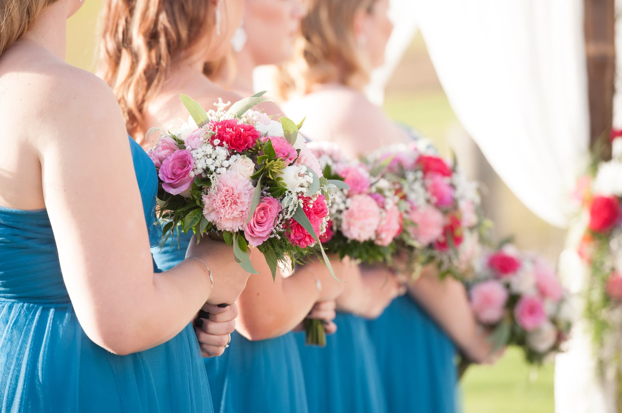 bridesmaids-in-a-row-holding-their-flowers