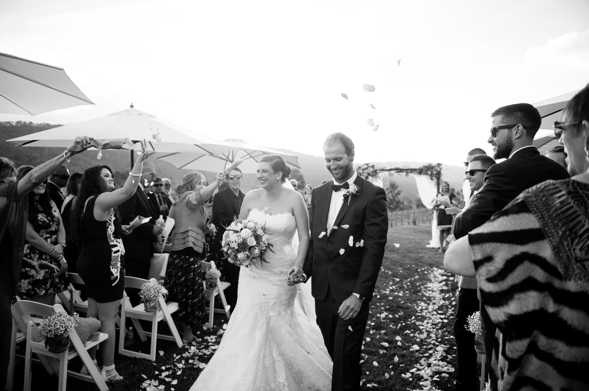 bride-and-groom-all-smiles-walking-down-the-isle-after-getting-married