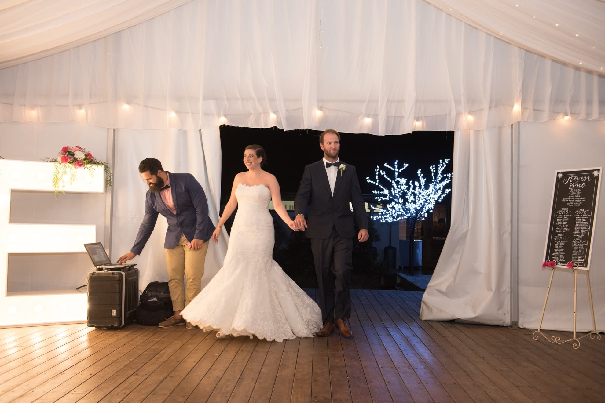 bride-and-groom-walk-into-their-bridal-reception